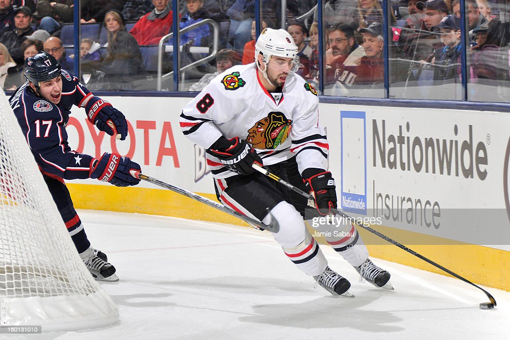 Nick Leddy #8 of the Chicago Blackhawks controls the puck in the third period as Brandon Dubinsky #17 of the Columbus Blue Jackets gives chase on January 26, 2013 at Nationwide Arena in Columbus, Ohio. Chicago defeated Columbus 3-2 to start the season 5-0 for the first time in team history.
