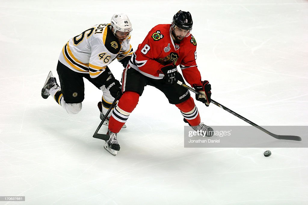 Nick Leddy #8 of the Chicago Blackhawks looks to move the puck against David Krejci #46 of the Boston Bruins in Game Two of the NHL 2013 Stanley Cup Final at United Center on June 15, 2013 in Chicago, Illinois.
