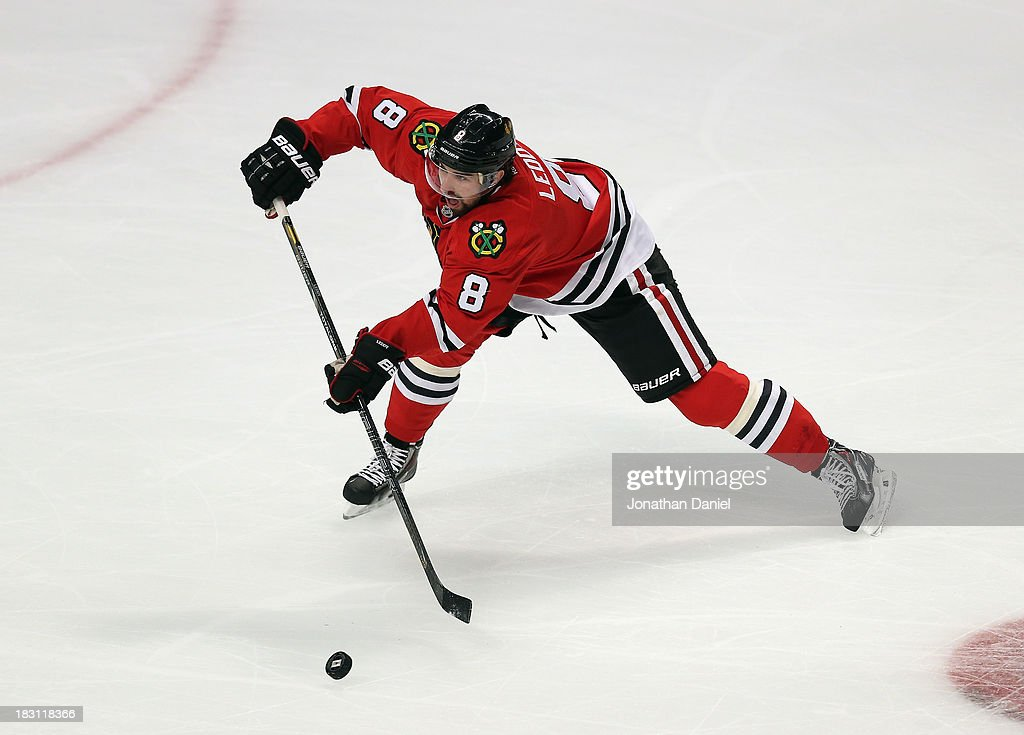 <a gi-track='captionPersonalityLinkClicked' href=/galleries/search?phrase=Nick+Leddy&family=editorial&specificpeople=5894600 ng-click='$event.stopPropagation()'>Nick Leddy</a> #8 of the Chicago Blackhawks passes the puck against the Washington Capitals at the United Center on October 1, 2013 in Chicago, Illinois. The Blackhawks defeated the Capitals 6-4.