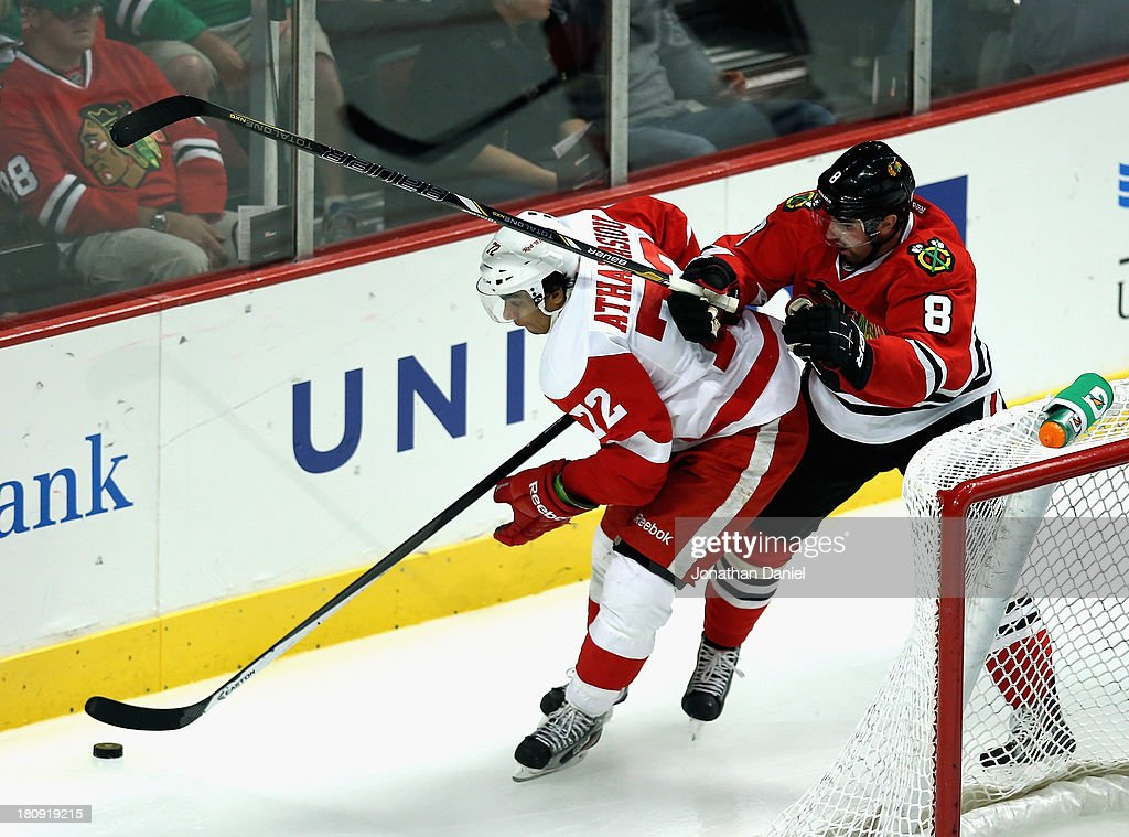 <a gi-track='captionPersonalityLinkClicked' href=/galleries/search?phrase=Nick+Leddy&family=editorial&specificpeople=5894600 ng-click='$event.stopPropagation()'>Nick Leddy</a> #8 of the Chicago Blackhawks pressures Andreas Athanasiou #72 of the Detroit Red Wings behind the net during an exhibition game at United Center on September 17, 2013 in Chicago, Illinois. The Blackhawks defeated the Red Wings 2-0.