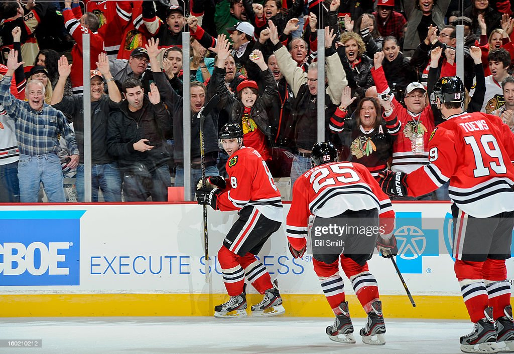 <a gi-track='captionPersonalityLinkClicked' href=/galleries/search?phrase=Nick+Leddy&family=editorial&specificpeople=5894600 ng-click='$event.stopPropagation()'>Nick Leddy</a> #8 of the Chicago Blackhawks reacts after scoring the winning goal in overtime during the NHL game against the Detroit Red Wings on January 27, 2013 at the United Center in Chicago, Illinois.