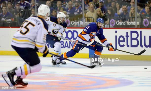 Nick Leddy of the New York Islanders chases the puck during the second period against the Buffalo Sabres at Barclays Center on October 7 2017 in the...