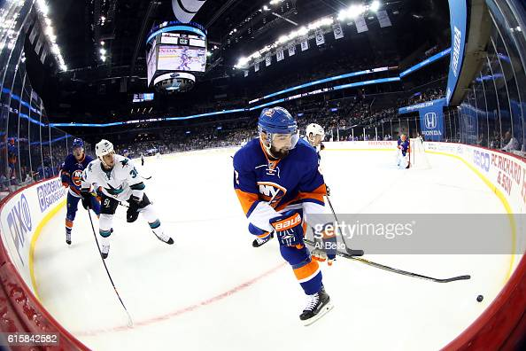 Nick Leddy of the New York Islanders handles the puck against Micheal Haley of the San Jose Sharks in the first periodat Barclays Center on October...