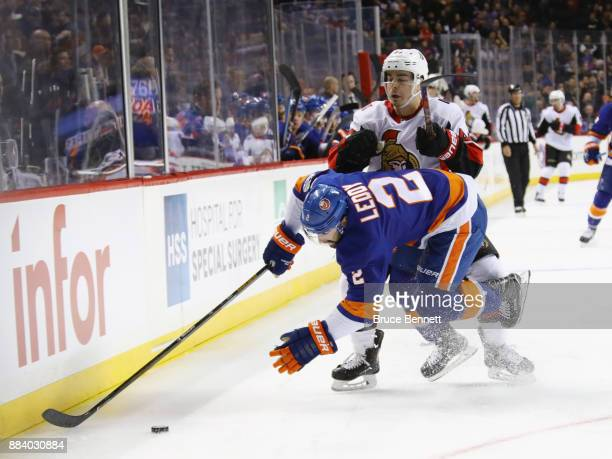 Nick Leddy of the New York Islanders is checked by JeanGabriel Pageau of the Ottawa Senators during the third period at the Barclays Center on...
