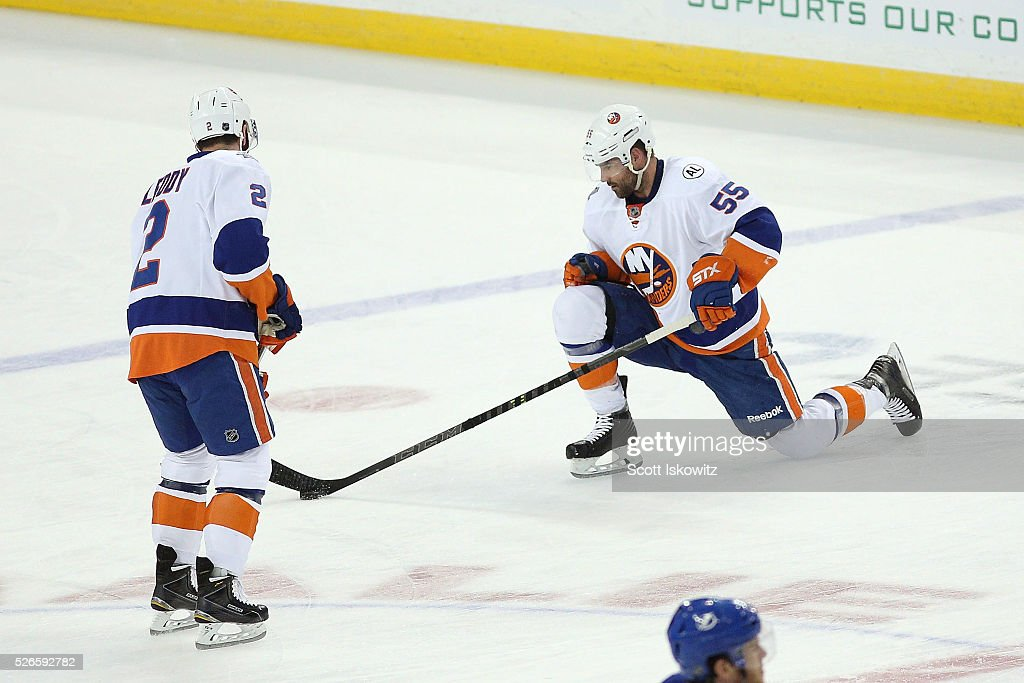 <a gi-track='captionPersonalityLinkClicked' href=/galleries/search?phrase=Nick+Leddy&family=editorial&specificpeople=5894600 ng-click='$event.stopPropagation()'>Nick Leddy</a> #2 of the New York Islanders passes the puck to teammate <a gi-track='captionPersonalityLinkClicked' href=/galleries/search?phrase=Johnny+Boychuk&family=editorial&specificpeople=2125695 ng-click='$event.stopPropagation()'>Johnny Boychuk</a> #55 of the New York Islanders while stretching during pregame skate in Game Two of the Eastern Conference Second Round during the 2016 NHL Stanley Cup Playoffs at Amalie Arena on April 30, 2016 in Tampa, Florida.