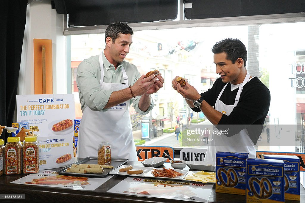 Nick Loeb (L) and Mario Lopez visit 'Extra' at The Grove on March 5, 2013 in Los Angeles, California.