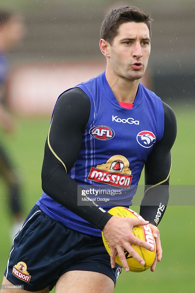 Nick Lower runs with the ball during a Western Bulldogs AFL training session at Whitten Oval on June 13, 2013 in Melbourne, Australia.