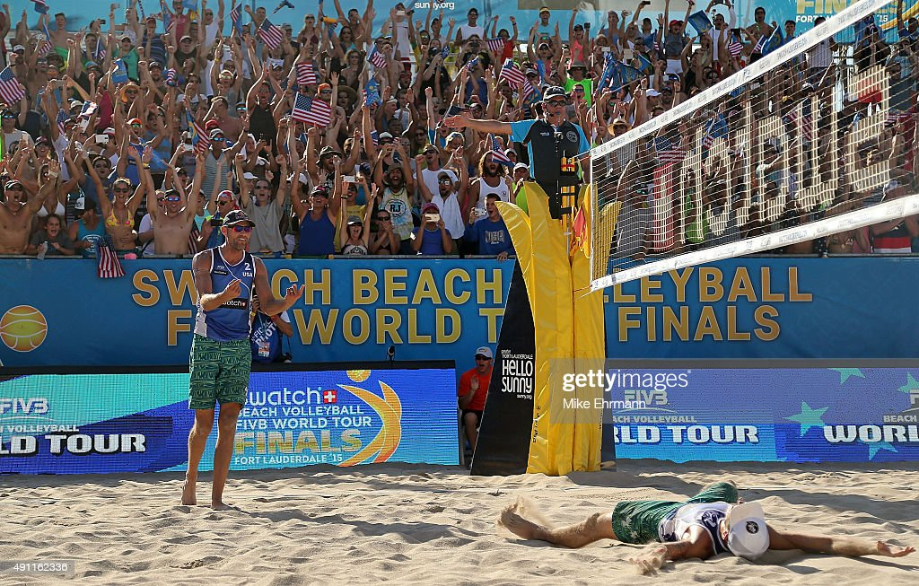 Nick Lucena and Phil Dalhausser of the United States celebrate after winning a match against Alexander Brouwer and Robert Meeuwsen of the Netherlands at the FIVB Fort Lauderdale Swatch Season Final at Fort Lauderdale Beach on October 3, 2015 in Fort Lauderdale, Florida.
