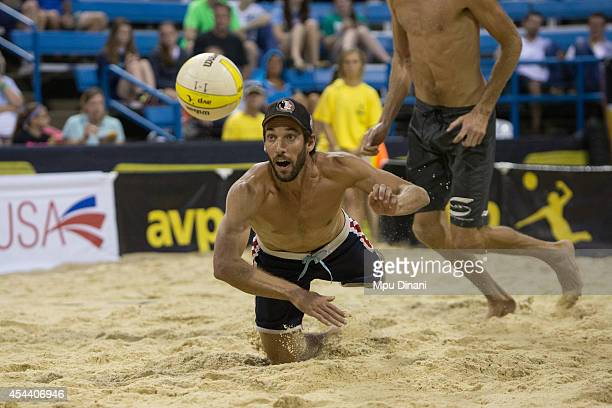 Nick Lucena digs the ball as Ryan Doherty moves into postition during the night session at the 2014 AVP Cincinnati Open on August 30 2014 at the...