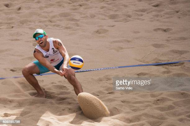 Nick Lucerna of the United States drops the ball during the semi final match against Piotr Kantor and Bartosz Losiak of Poland at the Swatch Beach...