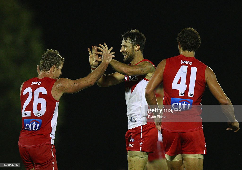 Nick Malceski and Luke Parkerof the Swans celebrate a goal during the round two NAB Cup AFL match between the Sydney Swans and the North Melbourne Kangaroos at Bruce Purser Oval on March 3, 2012 in Sydney, Australia.