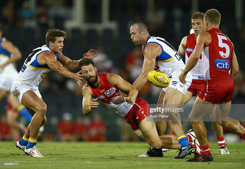 Nick Malceski of the Swans gets a handball away despite pressure from David Swallow of the Suns during the round three NAB Cup AFL match between the Sydney Swans and the Gold Coast Suns at Blacktown International Sportspark on March 9, 2013 in Sydney, Australia.