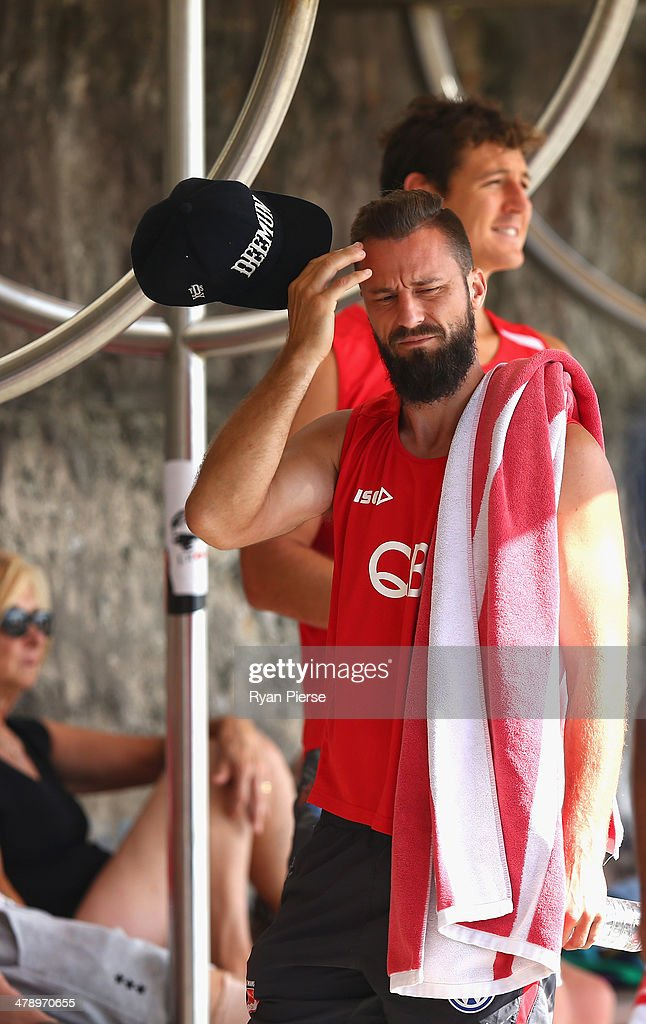 Nick Malceski of the Swans looks on during a Sydney Swans AFL recovery session at Coogee Beach on March 16, 2014 in Sydney, Australia.