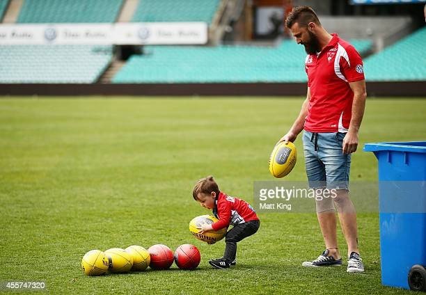 Nick Malceski of the Swans plays with his son Harrison during a Sydney Swans AFL recovery session at the Sydney Cricket Ground on September 20 2014...