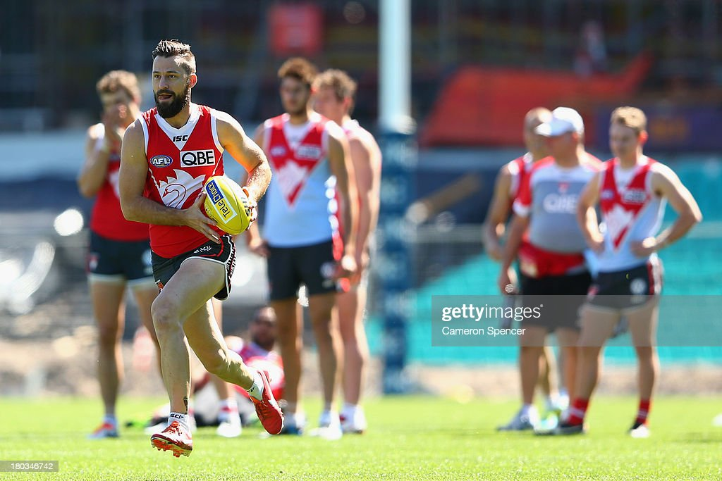 Nick Malceski of the Swans runs the ball during a Sydney Swans AFL training session at Sydney Cricket Ground on September 12, 2013 in Sydney, Australia.