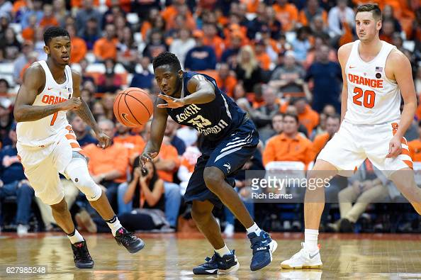 Nick Malonga of the North Florida Ospreys reaches for a loose ball between Frank Howard and Tyler Lydon of the Syracuse Orange during the second half...