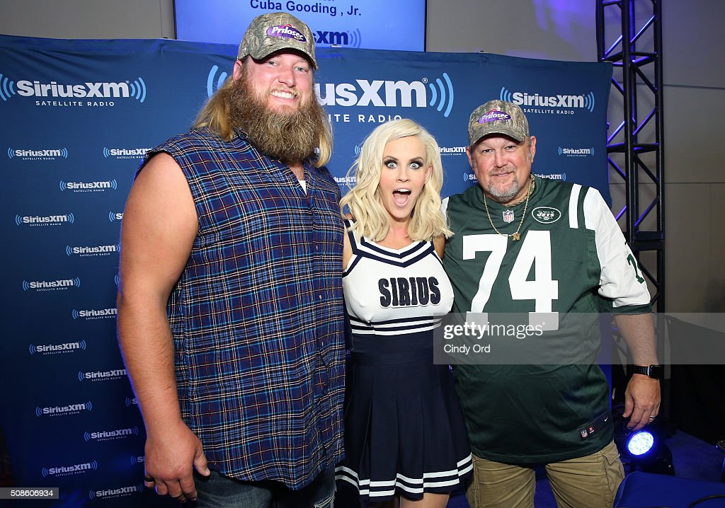<a gi-track='captionPersonalityLinkClicked' href=/galleries/search?phrase=Nick+Mangold&family=editorial&specificpeople=566704 ng-click='$event.stopPropagation()'>Nick Mangold</a> of the New York Jets, actress/model <a gi-track='captionPersonalityLinkClicked' href=/galleries/search?phrase=Jenny+McCarthy&family=editorial&specificpeople=202900 ng-click='$event.stopPropagation()'>Jenny McCarthy</a> and <a gi-track='captionPersonalityLinkClicked' href=/galleries/search?phrase=Larry+the+Cable+Guy&family=editorial&specificpeople=609437 ng-click='$event.stopPropagation()'>Larry the Cable Guy</a> visit the SiriusXM set at Super Bowl 50 Radio Row at the Moscone Center on February 5, 2016 in San Francisco, California.