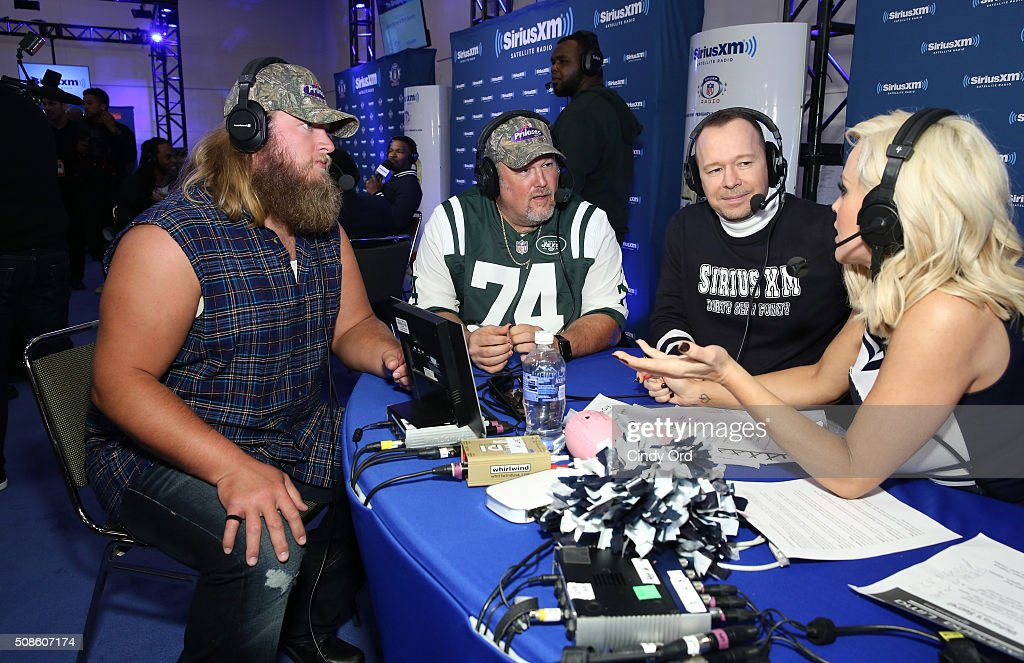 Nick Mangold of the New York Jets, Larry the Cable Guy, actor Donnie Wahlberg and actress/model Jenny McCarthy visit the SiriusXM set at Super Bowl 50 Radio Row at the Moscone Center on February 5, 2016 in San Francisco, California.