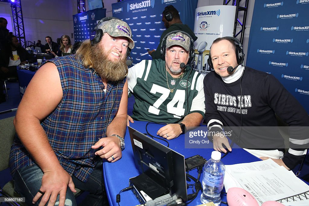 <a gi-track='captionPersonalityLinkClicked' href=/galleries/search?phrase=Nick+Mangold&family=editorial&specificpeople=566704 ng-click='$event.stopPropagation()'>Nick Mangold</a> of the New York Jets, Larry the Cable Guy and actor <a gi-track='captionPersonalityLinkClicked' href=/galleries/search?phrase=Donnie+Wahlberg&family=editorial&specificpeople=220537 ng-click='$event.stopPropagation()'>Donnie Wahlberg</a> visit the SiriusXM set at Super Bowl 50 Radio Row at the Moscone Center on February 5, 2016 in San Francisco, California.