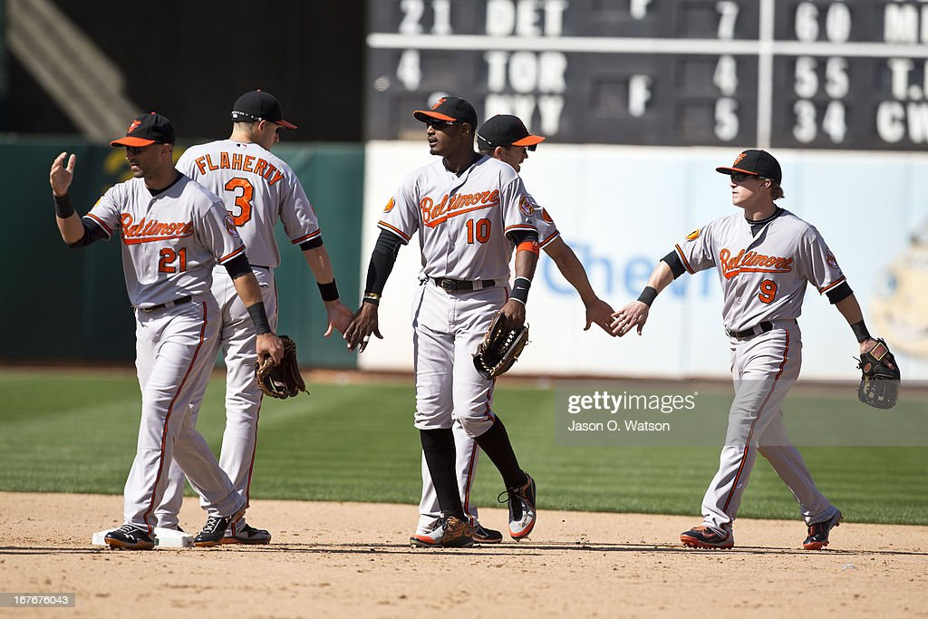 <a gi-track='captionPersonalityLinkClicked' href=/galleries/search?phrase=Nick+Markakis&family=editorial&specificpeople=614708 ng-click='$event.stopPropagation()'>Nick Markakis</a> #21, Adam Jones #10, and <a gi-track='captionPersonalityLinkClicked' href=/galleries/search?phrase=Nate+McLouth&family=editorial&specificpeople=536572 ng-click='$event.stopPropagation()'>Nate McLouth</a> #9 of the Baltimore Orioles celebrate with teammates after the game against the Oakland Athletics at O.co Coliseum on April 27, 2013 in Oakland, California. The Baltimore Orioles defeated the Oakland Athletics 7-3.
