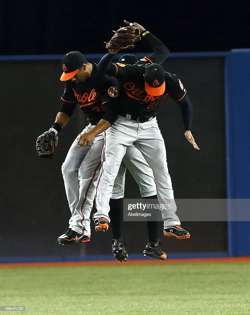 Nick Markakis #21, Adam Jones #10 and Steve Pearce #28 of the Baltimore Orioles celebrate the win against the Toronto Blue Jays during MLB action at the Rogers Centre May 24, 2013 in Toronto, Ontario, Canada.