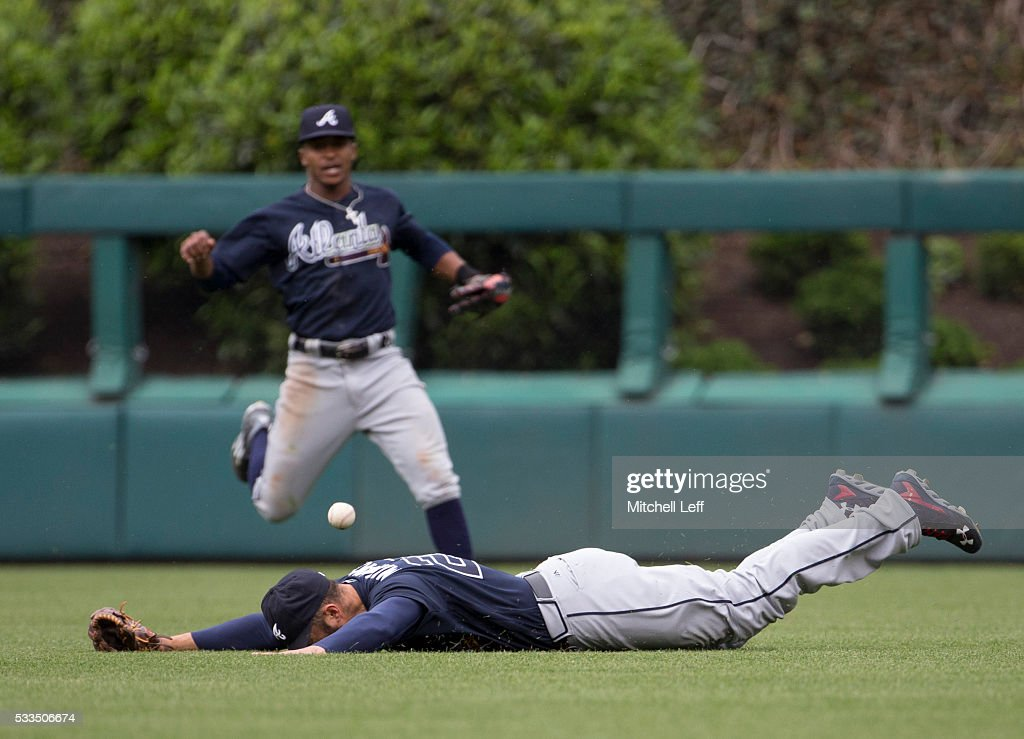 <a gi-track='captionPersonalityLinkClicked' href=/galleries/search?phrase=Nick+Markakis&family=editorial&specificpeople=614708 ng-click='$event.stopPropagation()'>Nick Markakis</a> #22 of the Atlanta Braves cannot make the diving catch on a ball hit by Maikel Franco #7 of the Philadelphia Phillies in the bottom of the sixth inning at Citizens Bank Park on May 22, 2016 in Philadelphia, Pennsylvania. The Phillies defeated the Braves 5-0.