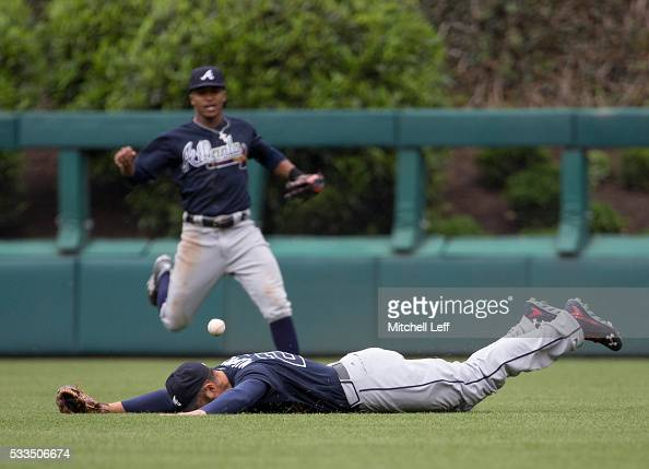 Nick Markakis of the Atlanta Braves cannot make the diving catch on a ball hit by Maikel Franco of the Philadelphia Phillies in the bottom of the...