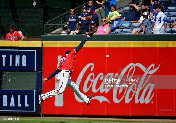 Nick Markakis of the Atlanta Braves can't catch a ball hit by James Loney of the New York Mets in the fifth inning of the game at Turner Field on...
