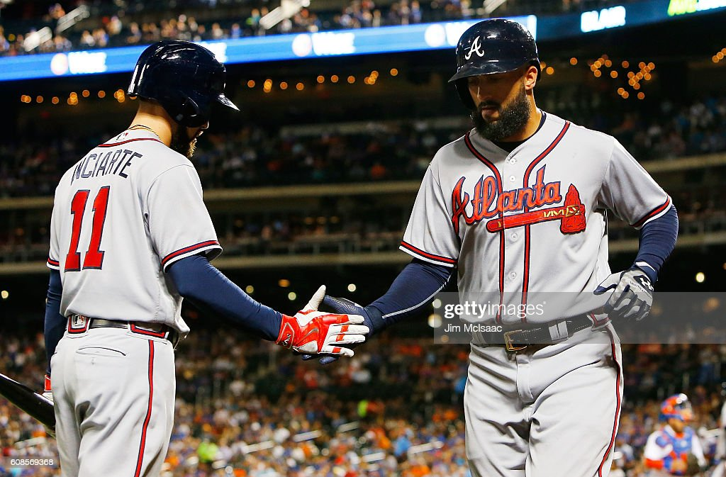 Nick Markakis #22 of the Atlanta Braves celebrates his first-inning run against the New York Mets with teammate Ender Inciarte #11 at Citi Field on September 19, 2016 in the Flushing neighborhood of the Queens borough of New York City.