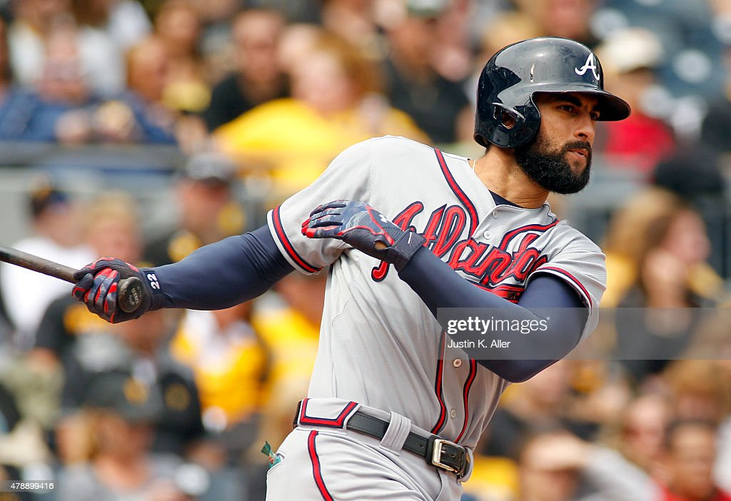 Nick Markakis of the Atlanta Braves hits a RBI single in the fifth inning during the game against the Pittsburgh Pirates at PNC Park on June 28 2015...
