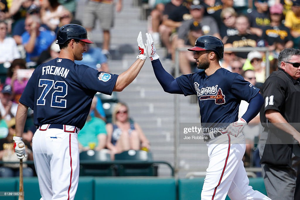 <a gi-track='captionPersonalityLinkClicked' href=/galleries/search?phrase=Nick+Markakis&family=editorial&specificpeople=614708 ng-click='$event.stopPropagation()'>Nick Markakis</a> #22 of the Atlanta Braves is congratulated by <a gi-track='captionPersonalityLinkClicked' href=/galleries/search?phrase=Nate+Freiman&family=editorial&specificpeople=9750566 ng-click='$event.stopPropagation()'>Nate Freiman</a> #72 after hitting a home run in the fifth inning of a spring training game against the Pittsburgh Pirates at Champion Stadium on March 5, 2016 in Lake Buena Vista, Florida. The Pirates defeated the Braves 9-6.