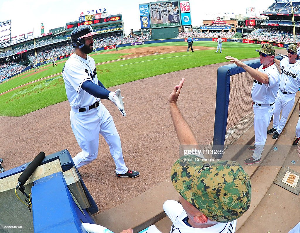 <a gi-track='captionPersonalityLinkClicked' href=/galleries/search?phrase=Nick+Markakis&family=editorial&specificpeople=614708 ng-click='$event.stopPropagation()'>Nick Markakis</a> #22 of the Atlanta Braves is congratulated by teammates after scoring a third inning run against the San Francisco Giants at Turner Field on May 30, 2016 in Atlanta, Georgia.