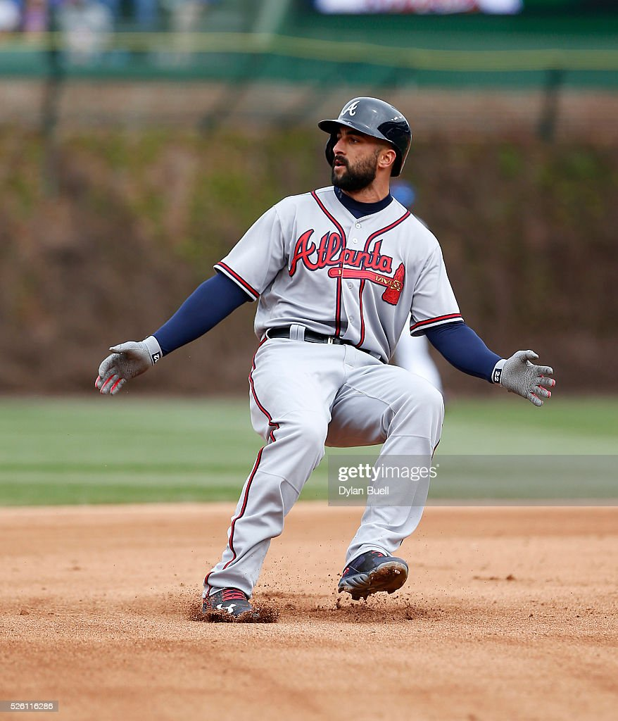 <a gi-track='captionPersonalityLinkClicked' href=/galleries/search?phrase=Nick+Markakis&family=editorial&specificpeople=614708 ng-click='$event.stopPropagation()'>Nick Markakis</a> #22 of the Atlanta Braves rounds second base in the sixth inning against the Chicago Cubs at Wrigley Field on April 29, 2016 in Chicago, Illinois.