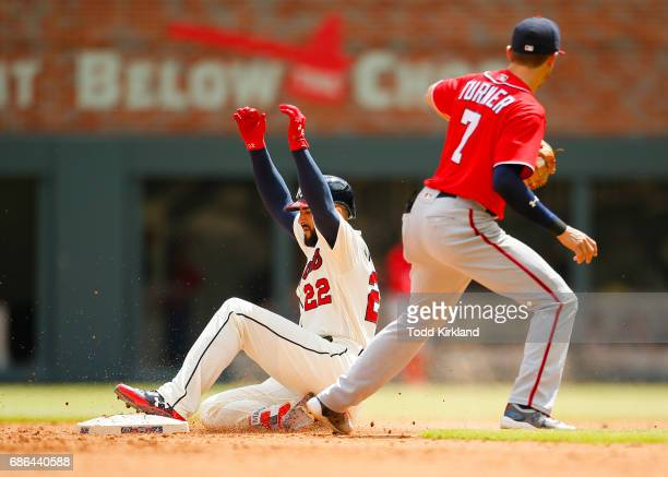 Nick Markakis of the Atlanta Braves slides in for a double in the eighth inning by Trea Turner of the Washington Nationals of an MLB game against the...