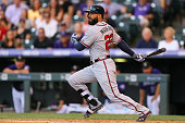 Nick Markakis of the Atlanta Braves watches his RBI infield single during the first inning against the Colorado Rockies at Coors Field on July 22...