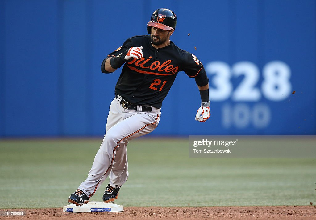 Nick Markakis #21 of the Baltimore Orioles advances from first base to third base on a double in the eighth inning during MLB game action against the Toronto Blue Jays on September 14, 2013 at Rogers Centre in Toronto, Ontario, Canada.