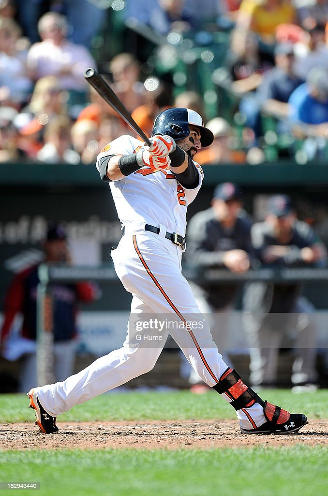 Nick Markakis #21 of the Baltimore Orioles bats against the Boston Red Sox at Oriole Park at Camden Yards on September 29, 2013 in Baltimore, Maryland.