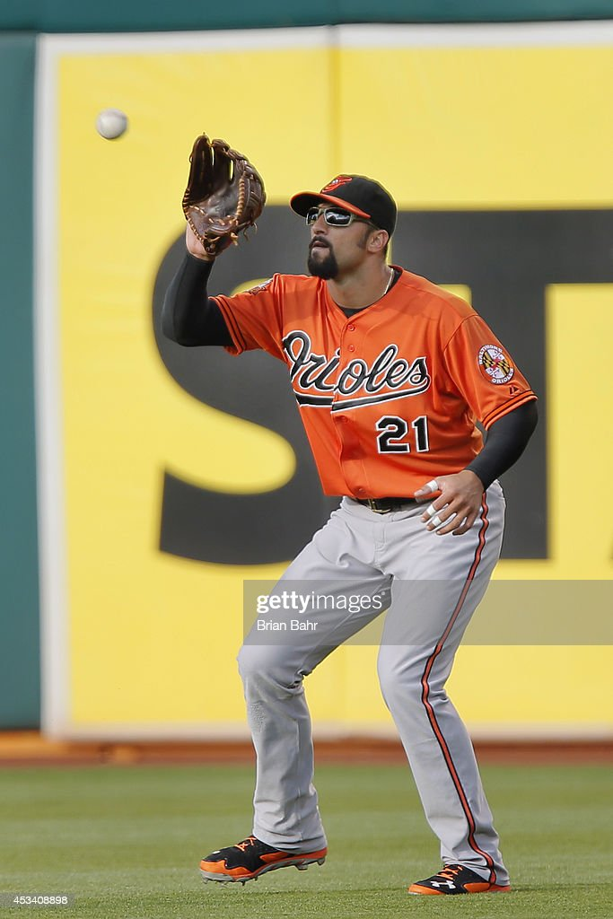 Nick Markakis of the Baltimore Orioles catches a fly ball off the bat of Jed Lowrie of the Oakland Athletics in the second inning at Oco Coliseum on...