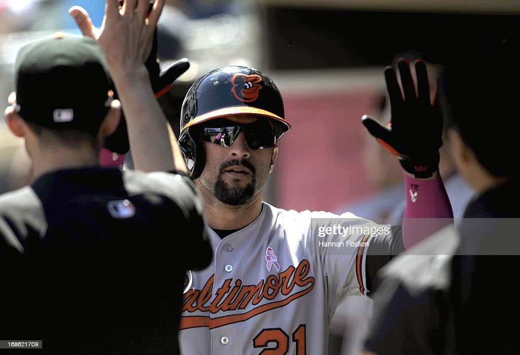 <a gi-track='captionPersonalityLinkClicked' href=/galleries/search?phrase=Nick+Markakis&family=editorial&specificpeople=614708 ng-click='$event.stopPropagation()'>Nick Markakis</a> #21 of the Baltimore Orioles celebrates scoring against the Minnesota Twins during the fifth inning of the game on May 12, 2013 at Target Field in Minneapolis, Minnesota.