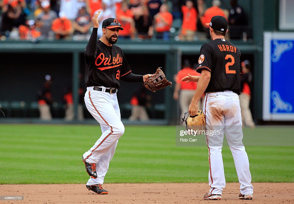 Nick Markakis of the Baltimore Orioles celebrates with JJ Hardy after defeating the Detroit Tigers 7 6 in Game Two of the American League Division...