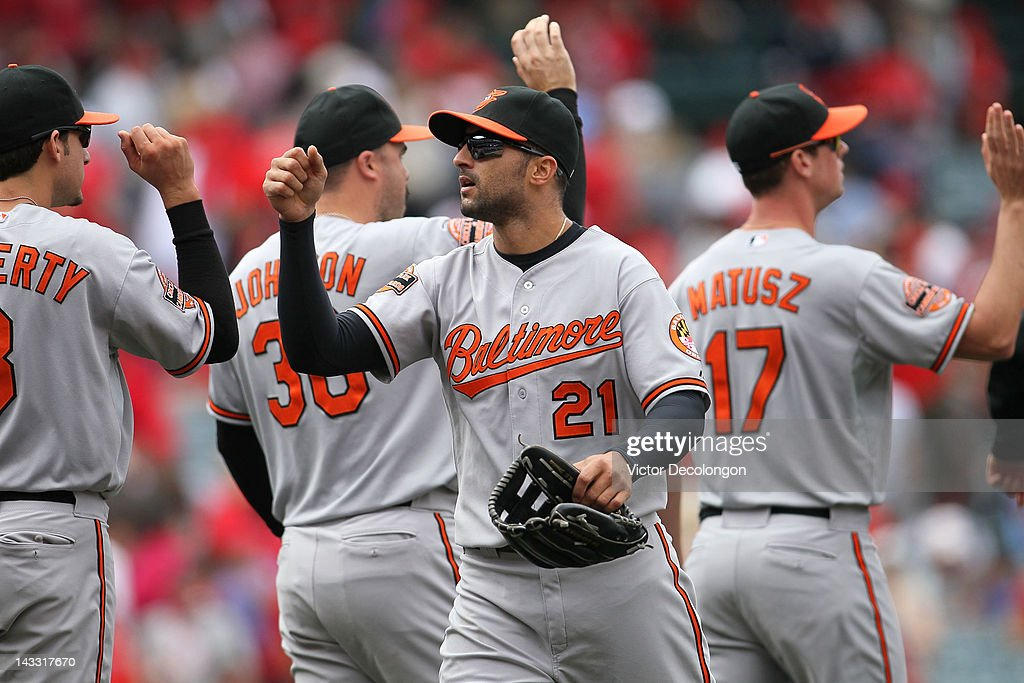 Nick Markakis #21 of the Baltimore Orioles celebrates with teammates after the MLB game against the Los Angeles Angels of Anaheim at Angel Stadium of Anaheim on April 22, 2012 in Anaheim, California. The Orioles defeated the Angels 3-2 in ten innings.