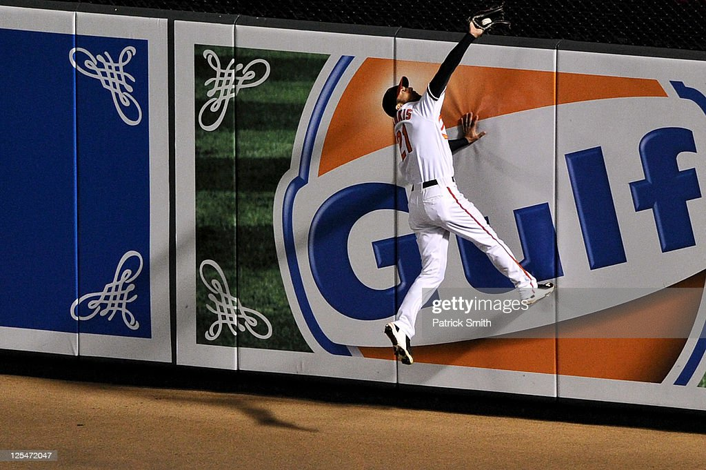 <a gi-track='captionPersonalityLinkClicked' href=/galleries/search?phrase=Nick+Markakis&family=editorial&specificpeople=614708 ng-click='$event.stopPropagation()'>Nick Markakis</a> #21 of the Baltimore Orioles crashes into the outfield wall after making an out against the Los Angeles Angels of Anaheim in the ninth inning at Oriole Park at Camden Yards on September 17, 2011 in Baltimore, Maryland. The Baltimore Orioles won, 6-2.