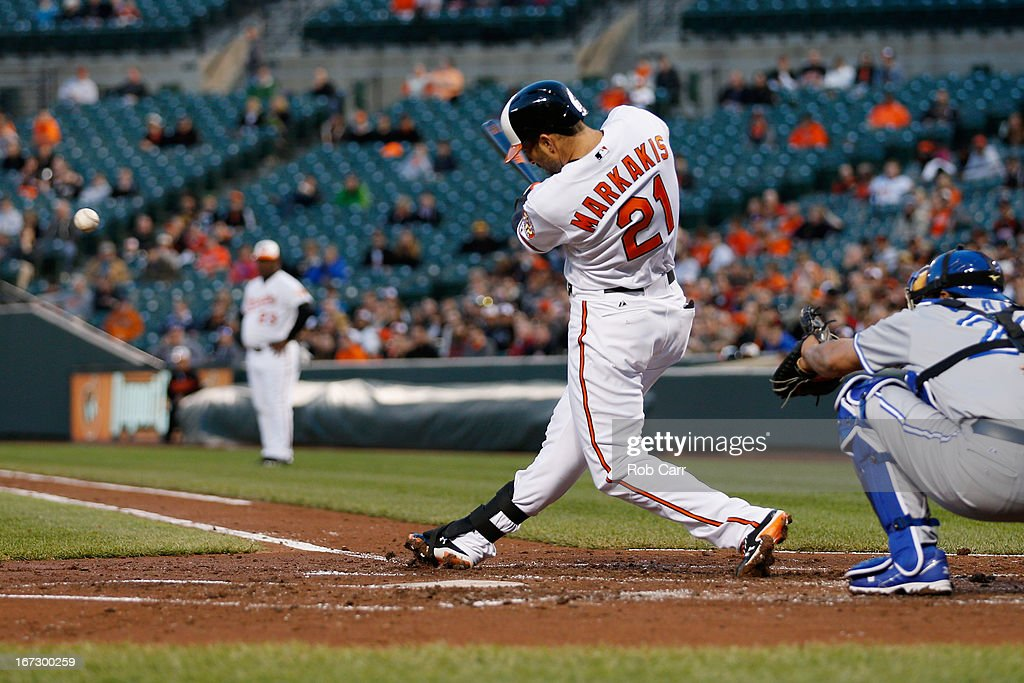 <a gi-track='captionPersonalityLinkClicked' href=/galleries/search?phrase=Nick+Markakis&family=editorial&specificpeople=614708 ng-click='$event.stopPropagation()'>Nick Markakis</a> #21 of the Baltimore Orioles gounds out as catcher <a gi-track='captionPersonalityLinkClicked' href=/galleries/search?phrase=Henry+Blanco&family=editorial&specificpeople=211366 ng-click='$event.stopPropagation()'>Henry Blanco</a> #22 of the Toronto Blue Jays looks on at Oriole Park at Camden Yards on April 23, 2013 in Baltimore, Maryland.