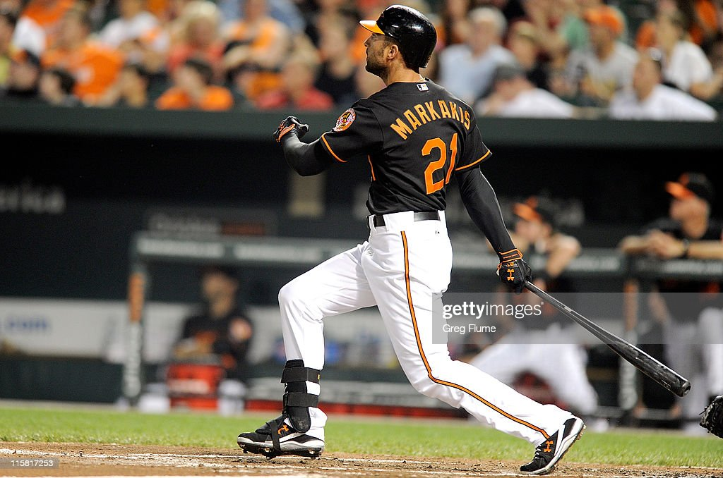 Nick Markakis of the Baltimore Orioles hits a grand slam in the second inning against the Tampa Bay Rays at Oriole Park at Camden Yards on June 10...