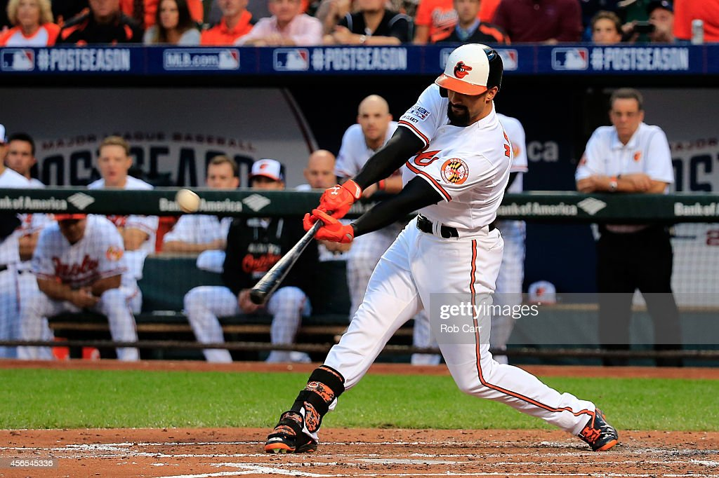 Nick Markakis of the Baltimore Orioles hits a RBI single to right center field in the second inning to score Ryan Flaherty against Max Scherzer of...