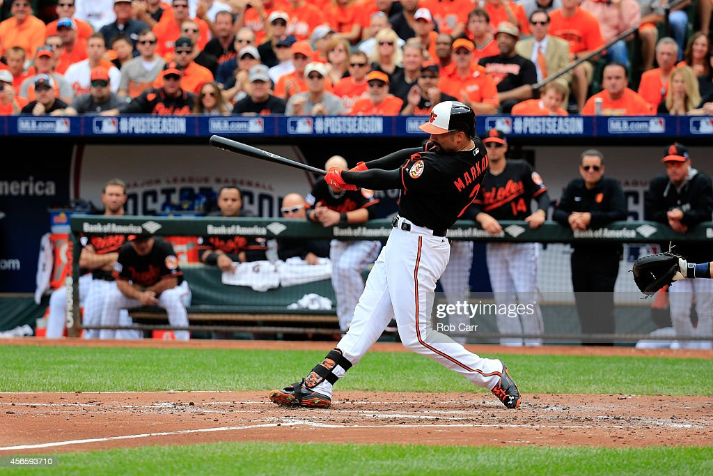 <a gi-track='captionPersonalityLinkClicked' href=/galleries/search?phrase=Nick+Markakis&family=editorial&specificpeople=614708 ng-click='$event.stopPropagation()'>Nick Markakis</a> #21 of the Baltimore Orioles hits a two run home run to right field scoring teammate Jonathan Schoop #6 in the third inning against Justin Verlander #35 of the Detroit Tigers during Game Two of the American League Division Series at Oriole Park at Camden Yards on October 3, 2014 in Baltimore, Maryland.