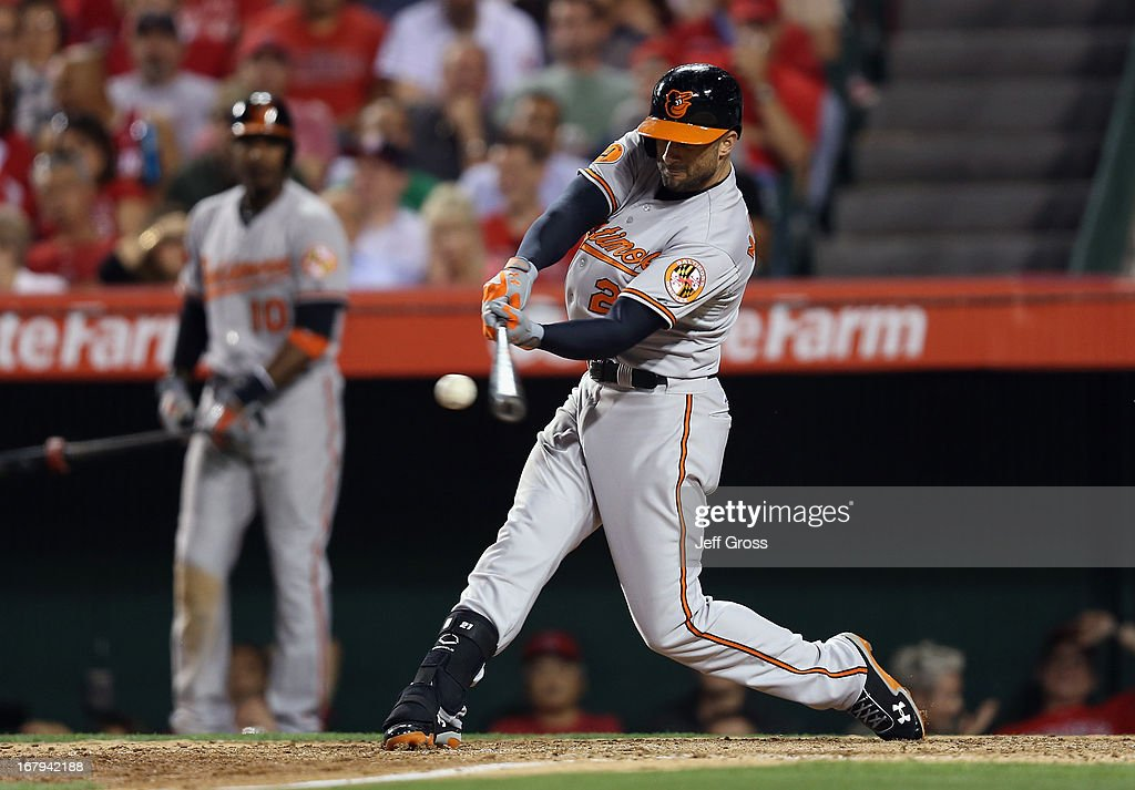 <a gi-track='captionPersonalityLinkClicked' href=/galleries/search?phrase=Nick+Markakis&family=editorial&specificpeople=614708 ng-click='$event.stopPropagation()'>Nick Markakis</a> #21 of the Baltimore Orioles hits an RBI double against the Los Angeles Angels of Anaheim in the seventh inning at Angel Stadium of Anaheim on May 2, 2013 in Anaheim, California.
