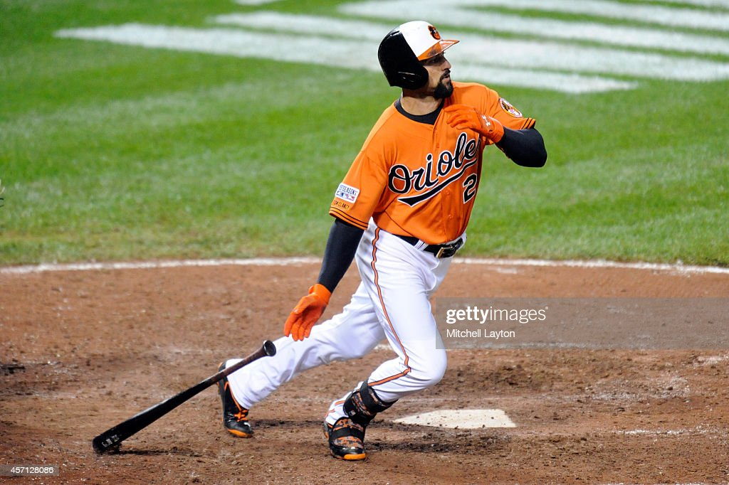Nick Markakis of the Baltimore Orioles hits the ball against the Kansas City Royals during Game Two of the American League Championship Series at...