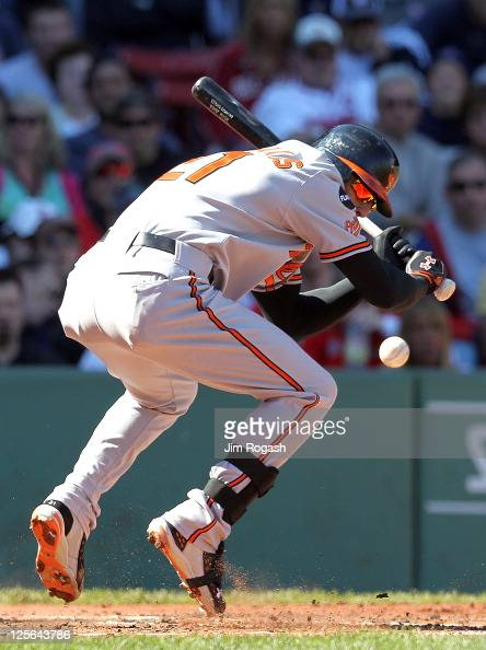 Nick Markakis of the Baltimore Orioles is hit by a pitch during a game with the Boston Red Sox at Fenway Park September 19 2011 in Boston...