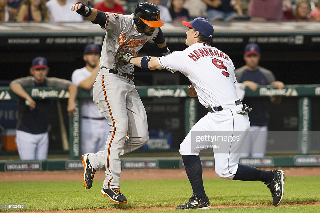 <a gi-track='captionPersonalityLinkClicked' href=/galleries/search?phrase=Nick+Markakis&family=editorial&specificpeople=614708 ng-click='$event.stopPropagation()'>Nick Markakis</a> #21 of the Baltimore Orioles is tagged out by third baseman <a gi-track='captionPersonalityLinkClicked' href=/galleries/search?phrase=Jack+Hannahan&family=editorial&specificpeople=579381 ng-click='$event.stopPropagation()'>Jack Hannahan</a> #9 of the Cleveland Indians during the eighth inning at Progressive Field on July 23, 2012 in Cleveland, Ohio.